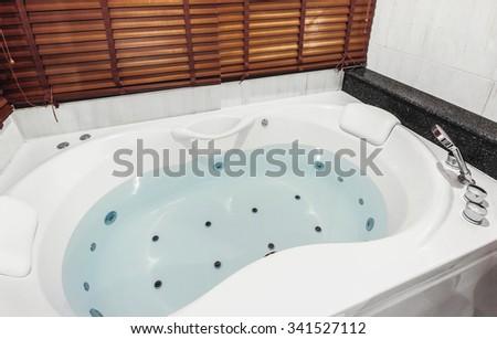 jacuzzi bath tub with water - stock photo