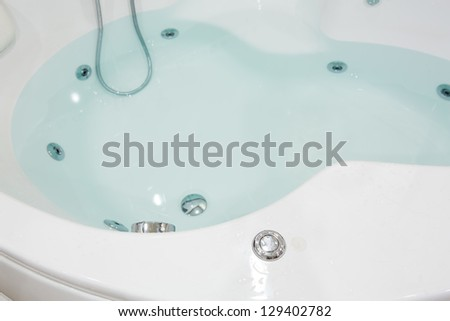 Jacuzzi in bathroom - stock photo