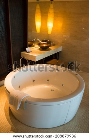 Jacuzzi tub in the luxurious hotel - stock photo