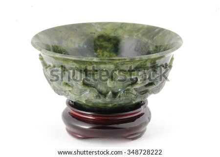Jade bowl with wooden base isolated on white background. - stock photo