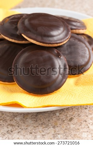 Jaffa cakes a sponge base cake with a layer of orange flavoured jelly coated with dark chocolate - stock photo