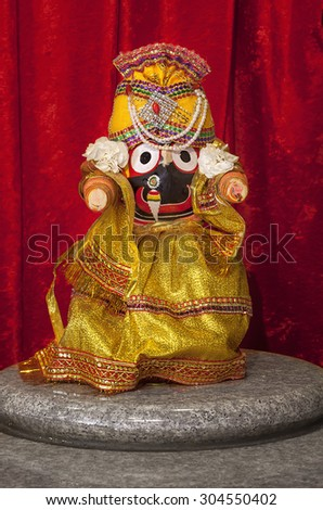 Jagannath - Lord of the universe, in Hindu Temple. The icon of Jagannath is a carved and decorated wooden stump with large round eyes and with stumps as hands, with the conspicuous absence of legs - stock photo