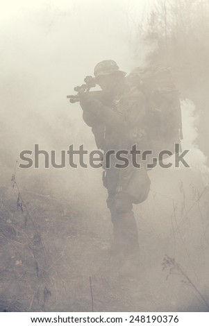 Jagdkommando soldier Austrian special forces in the smoke  - stock photo