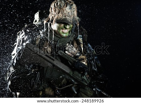 Jagdkommando soldier Austrian special forces with rifle in the rain  - stock photo