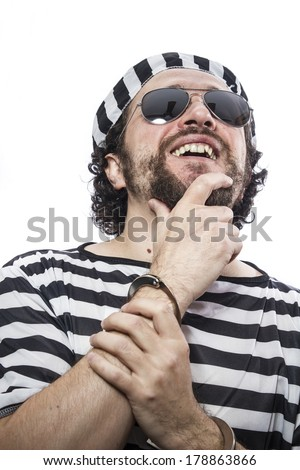 Jail, Desperate, portrait of a man prisoner in prison garb, over white background - stock photo