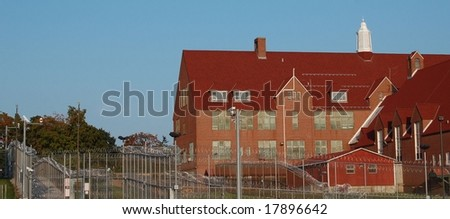 jail with barb wire fence - stock photo