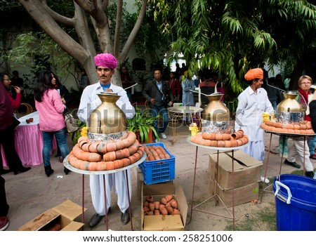 JAIPUR, INDIA - JAN 21: Men in traditional Rajasthan dresses prepare tea masala during the Jaipur Literature Festival on January 21, 2015. World's largest free literary festival had start in 2006 - stock photo