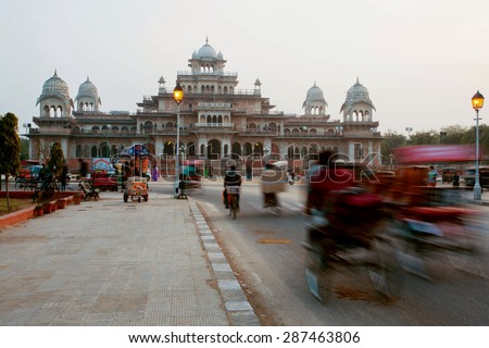 JAIPUR, INDIA - JAN 25: Motion blurs from rickshaw and cars on busy street near famous Albert Hall Museum on January 25, 2015. Jaipur, with population 6,664,000 people, is a capital of Rajasthan - stock photo