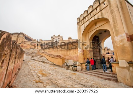 JAIPUR, INDIA - JAN 23: Open gates of the Amber Fort and tourists coming in the historical landmark on January 23, 2015 in Rajasthan. Amber Fort was built in 1592 by king Raja Man Singh.  - stock photo