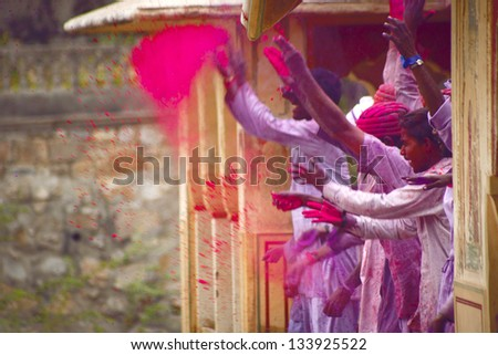 JAIPUR, INDIA - MARCH 17:People covered in paint on Holi festival, March 17, 2013, Jaipur, India. Holi, the festival of colors, marks the arrival of spring, one of the biggest festivals in India - stock photo