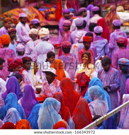 JAIPUR, INDIA - MARCH 17: People covered in paint on Holi festival, March 17, 2013, Jaipur, India. Holi, the festival of colors, marks the arrival of spring, one of the biggest festivals in India  - stock photo