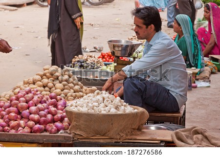 JAIPUR, INDIA - MARCH 26, 2014: Traders in the fruit and vegetable market in the old Johari Bazaar district of the city - stock photo