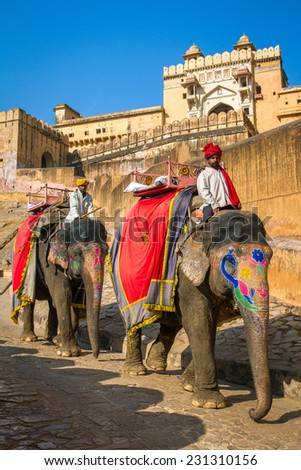 JAIPUR, INDIA - NOVEMBER, 28: Elephant riders in the Amber Fort near Jaipur, Rajasthan, India on November 28, 2012. - stock photo