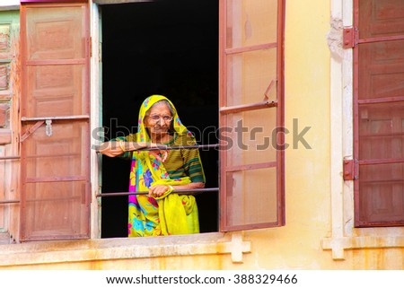JAIPUR, INDIA - NOVEMBER 13: Unidentified woman looks out of the window on November 13, 2014 in Jaipur, India. Jaipur is the capital and the largest city of  Rajasthan.