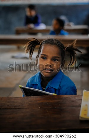 JAIPUR-MARCH 04 :child posing in the classroom  on March 04, 2014 in Jaipur,india