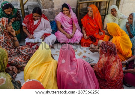 JAIPUR-MARCH 04 :women preparing for religious celebration in the street on March 04, 2014 in Jaipur,india