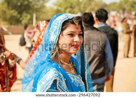 JAISALMER, INDIA - FEB 1: Face of young indian women in the colorful sari in the rural Desert Festival on February 1, 2015 in Rajasthan. Every winter Jaisalmer takes the Desert Festival - stock photo