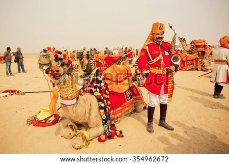 JAISALMER, INDIA - FEB 2: Saxophone player in uniform of orchestra member ready to play on the Desert Festival on February 2, 2015. Every winter Jaisalmer takes famous Desert Festival of Rajasthan - stock photo