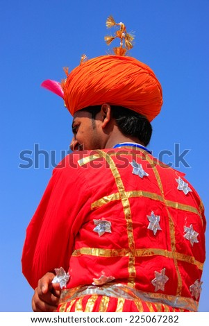 JAISALMER, INDIA - FEBRUARY 16: Unidentified man takes part in Desert Festival on February 16, 2011 in Jaisalmer, India. Main purpose of this Festival is to display colorful culture of Rajasthan