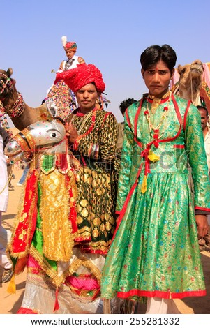 JAISALMER, INDIA - FEBRUARY 16: Unidentified men take part in Desert Festival on February 16, 2011 in Jaisalmer, India. Main purpose of this Festival is to display colorful culture of Rajasthan - stock photo