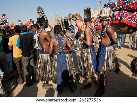 JAISALMER, INDIA - MAR 1: Group of native tribes of the African continent arrived at the Desert Festival on March 1, 2015 in Rajasthan. Every winter Jaisalmer takes the famous Desert Festival