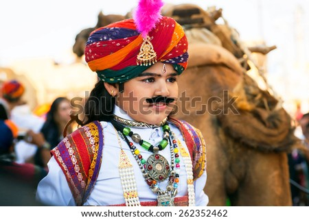 JAISALMER, INDIA - MAR 1: Unidentified child with fake mustache and traditional rajput costume on the carnaval of Desert Festival on March 1, 2015. Every winter Jaisalmer takes famous Desert Festival
