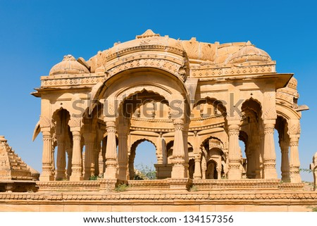 JAISALMER, INDIA - NOV 29: Chhatris on ruins of the royal cenotaphs of ancient Maharajas rulers in Bada Bagh, also called Barabagh (literally Big Garden) on Nov 29, 2012 in Jaisalmer, India