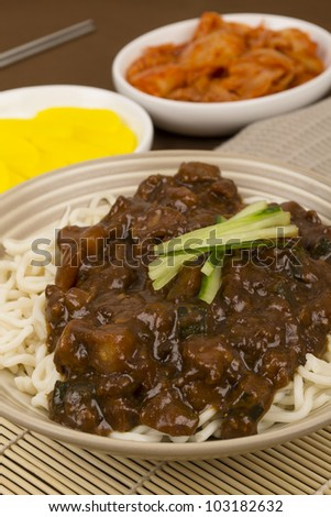Jajangmyeon - Korean / Chinese pork, vegetables and black bean paste noodles served with danmuji and kimchi.