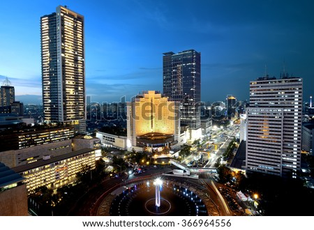 Jakarta city at night with modern building - stock photo
