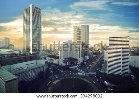 Jakarta city with modern building and sunset sky - stock photo