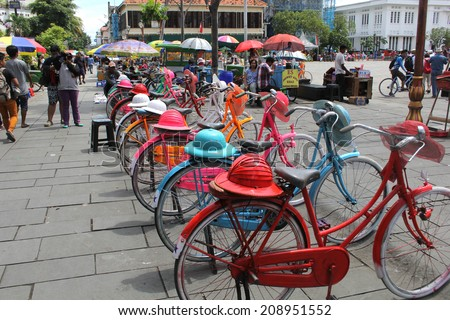 JAKARTA, INDONESIA, APRIL 6, 2014:  Colorful bicycles lined up for hire in Fatahilah Square in Jakarta's Old Town on April 6, 2014.  Bicycling is popular among the visiting locals and tourists alike. - stock photo