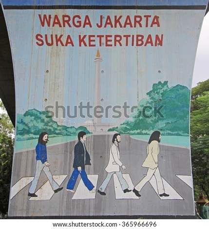 JAKARTA, INDONESIA - APRIL 23, 2015: Graffiti with reference to cover of Beatles album 'Abbey Road' in Jakarta, Indonesia - stock photo