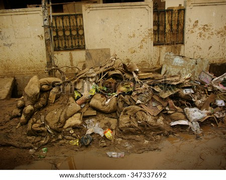 JAKARTA, INDONESIA - February 12, 2007: Ruined household belongings outside a house after severe El Niño flooding hit Indonesia's capital city on February 12, 2007 in Jakarta, Java, Indonesia. - stock photo
