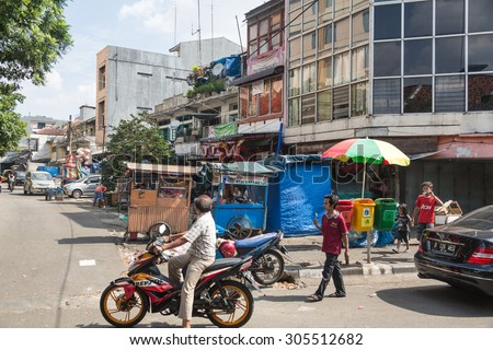 Jakarta, Indonesia - July 18 2015: City life captured in Glodok, Jakarta Chinatown in Indonesia capital city.