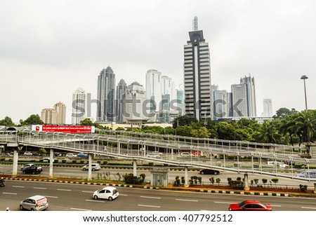 Jakarta, Indonesia - March 19, 2016:  Panorama of Jakarta skyscrapers at cloudy day