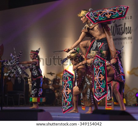JAKARTA, INDONESIA: NOVEMBER 13, 2015: Dancers perform a traditional Kalimantan Dayak dance at the opening ceremony of the 13th World Wushu Championship 2015 in Jakarta Convention Centre. - stock photo