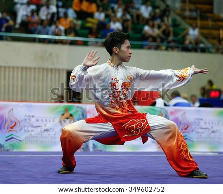 JAKARTA, INDONESIA - NOVEMBER 15, 2015: Yu Wei Chen of Chinese Taipei performs the movements in the men's Taijiquan event at the 13th World Wushu Championship 2015 held in Istora Senayan, Jakarta. - stock photo