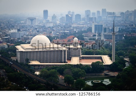 JAKARTA, INDONESIA - SEPTEMBER 6: Istiqlal Mosque and its surroundings on September 6, 2011 in Jakarta. Istiqlal Mosque is largest mosque in Southeast Asia with capacity of 120,000 worshipers. - stock photo