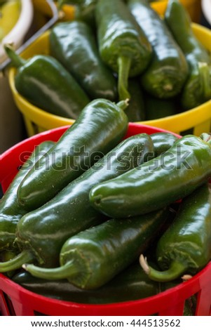 Jalapeno peppers in baskets for sale at farmers market in Asheville North Carolina