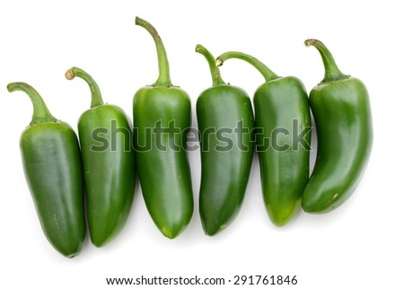 jalapeno peppers in row isolated on white  - stock photo
