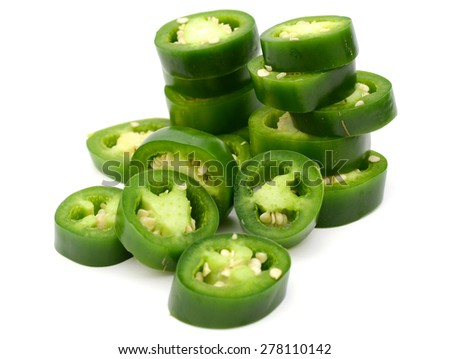 jalapeno peppers sliced on white background  - stock photo