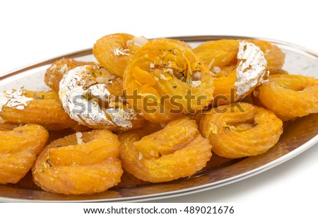Jalebi, also know as imarti, imarati, paneer jalebi or zulbia is a Indian sweet food isolated on white background, It is made by deep-frying a wheat flour batter in pretzel or circular shapes