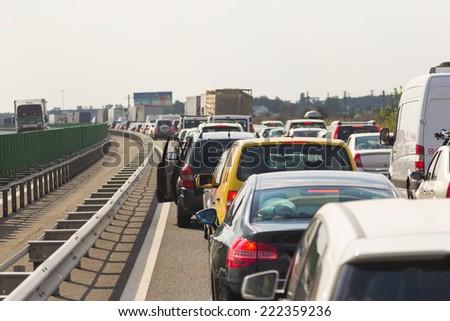 Jam on the highway. Traffic jam in rush hour. - stock photo