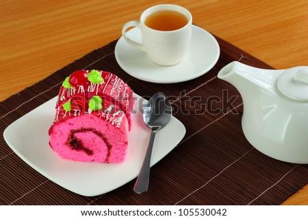 Jam roll cake and tea. - stock photo