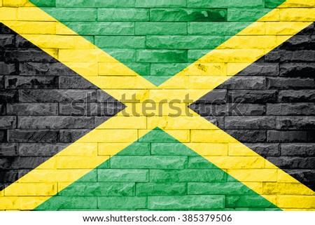 Jamaica flag on a brick wall background - stock photo