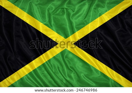 Jamaica flag pattern on the fabric texture ,vintage style - stock photo