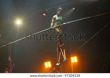 JAMAICA, NY - APRIL 30:  A high wire walker performs at the UniverSoul Circus April 30, 2005 in the Jamaica neighborhood of New York City. - stock photo