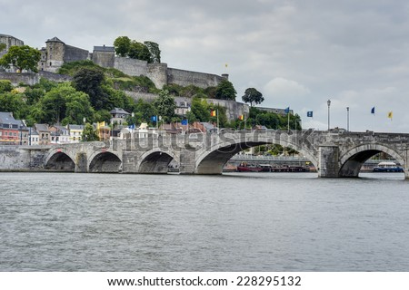 Jambes Bridge crossing the river Meuse as it passes through the city of Namur in the Wallonia Region, southern Belgium - stock photo