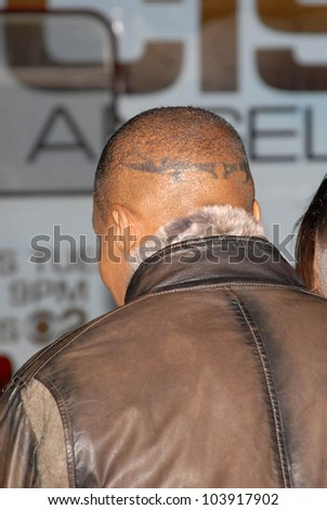 Jamie Foxx's tattoo at the Los Angeles Premiere of 'Law Abiding Citizen'. Grauman's Chinese Theatre, Hollywood, CA. 10-06-09 - stock photo