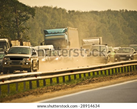 jammed traffic, dust and smog - stock photo